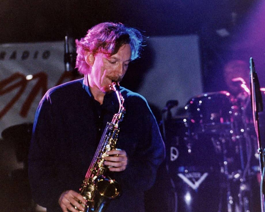 Mike Pickering from the band M People playing saxophone