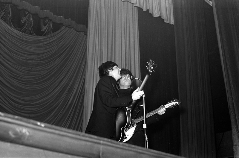 Paul McCartney and John Lennon performing at the ABC Cinema