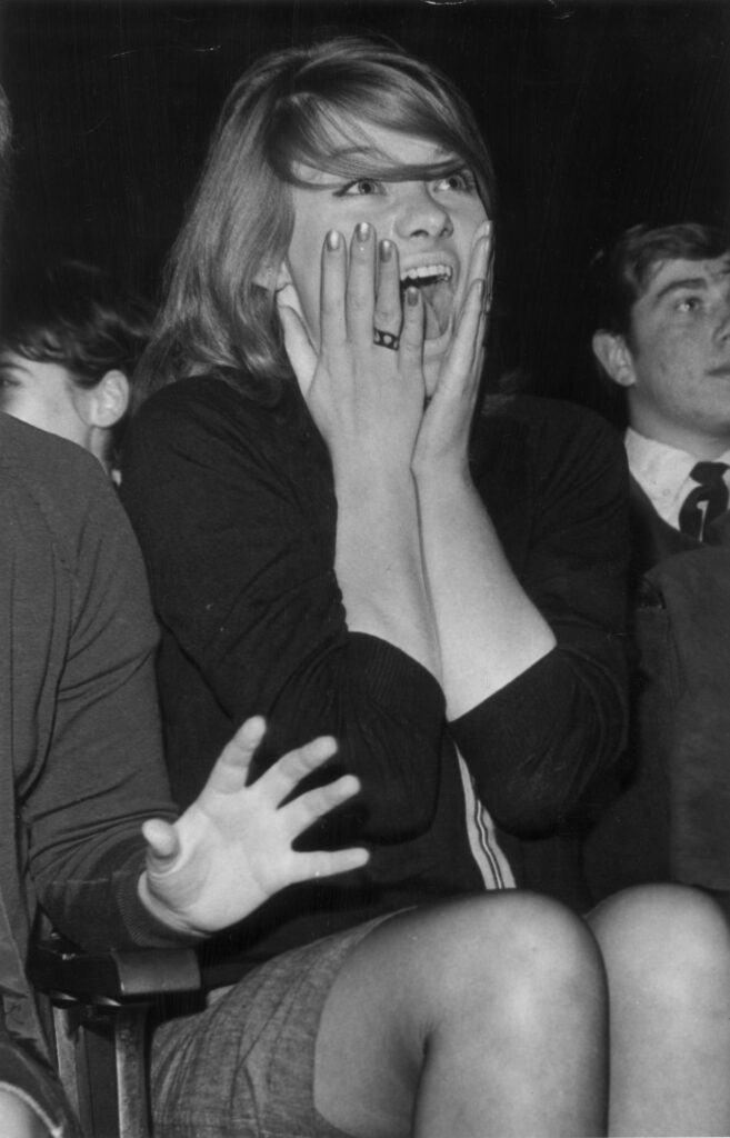 A fan watching a Beatles gig in 1963