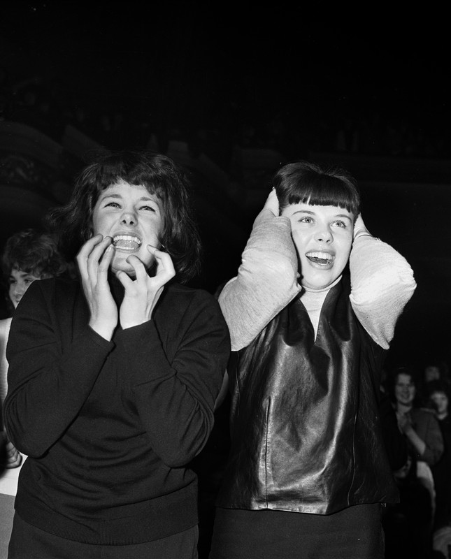 Two fans at a Beatles gig in 1963