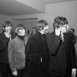 The Beatles wearing smog masks