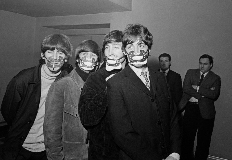 The Beatles in Manchester in 1965 wearing smog masks