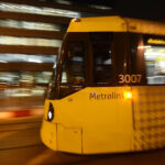 A yellow tram in Manchester City Centre