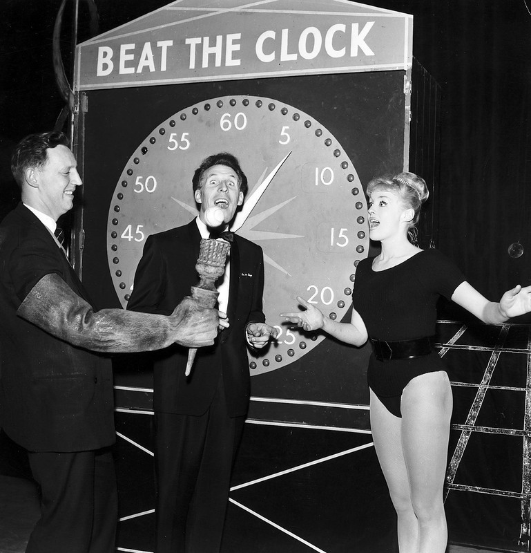 Bruce Forsyth standing in front of Beat The Clock