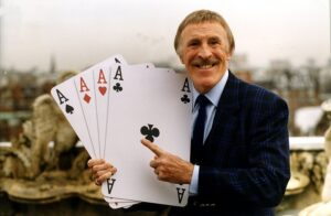 Bruce Forsyth holding some of the playing cards that were used on Play Your Cards Right