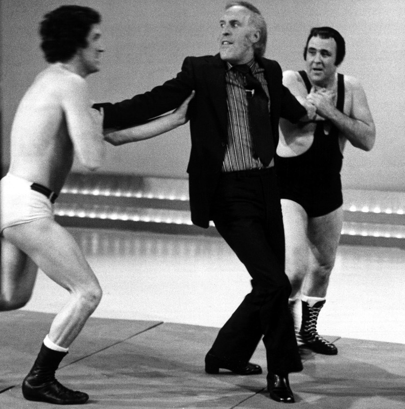 Bruce Forsyth taking part in a wrestling task on the Generation Game, 1972