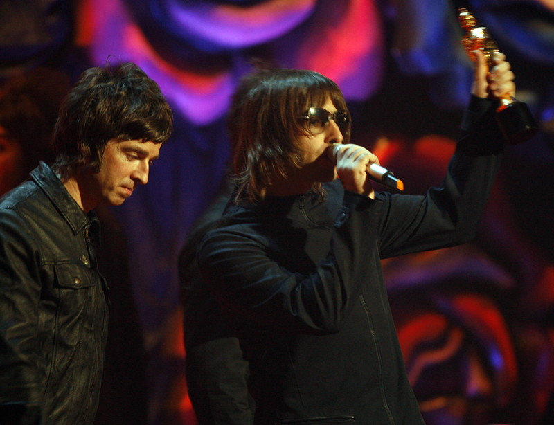 Liam and Noel Gallagher collecting the outstanding contribution to music award at the 2007 Brit Awards