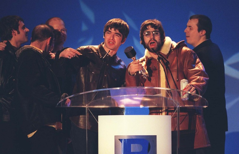Oasis collecting one of their awards at the Brit Awards 1996
