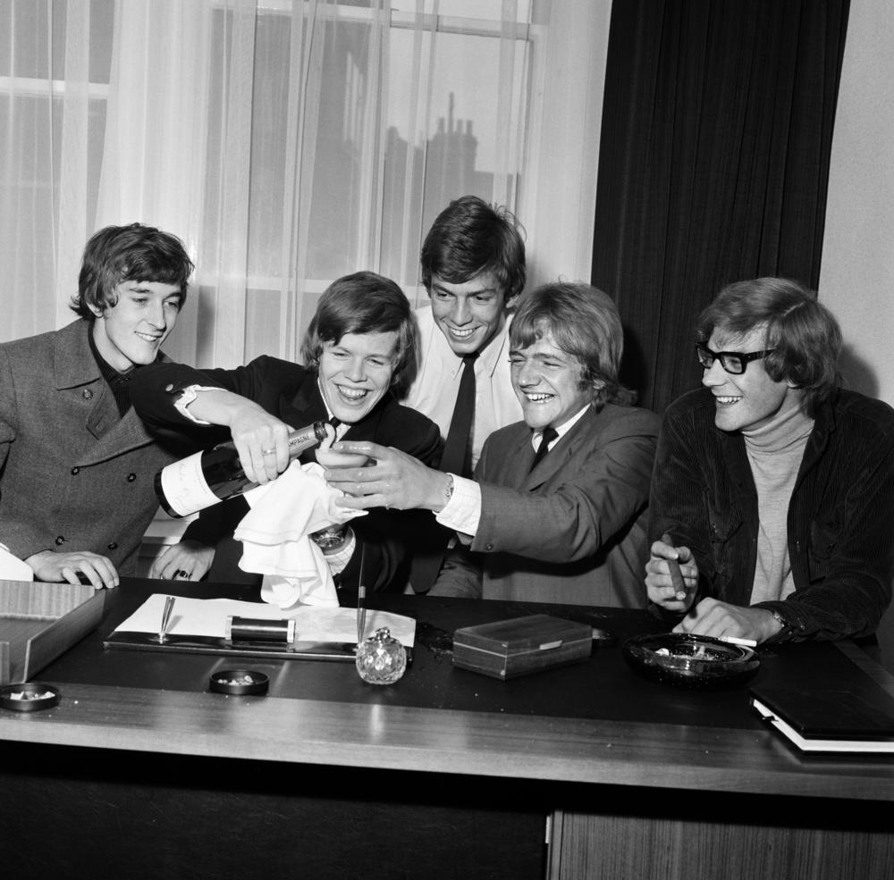 Herman's Hermits celebrating their deal with MGM