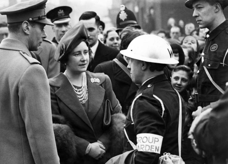 King George VI and Queen Elizabeth talking to a group warden in Salford.