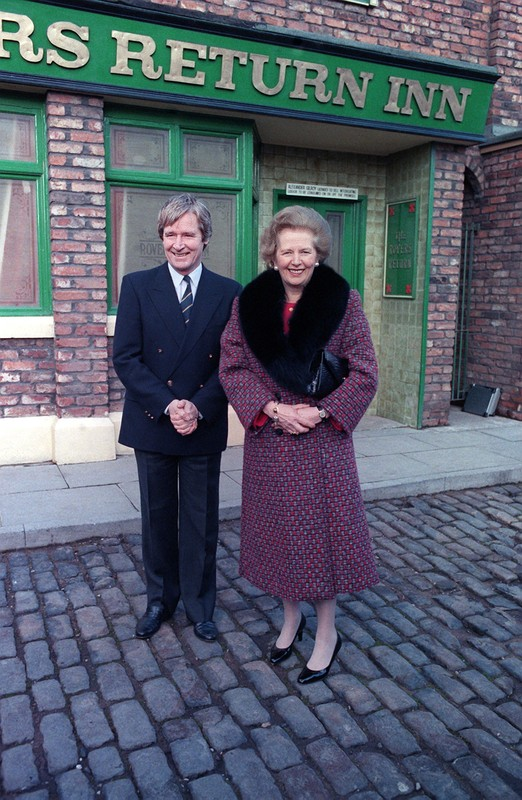 Margaret Thatcher on the Coronation Street set with William Roach during a visit in 1990