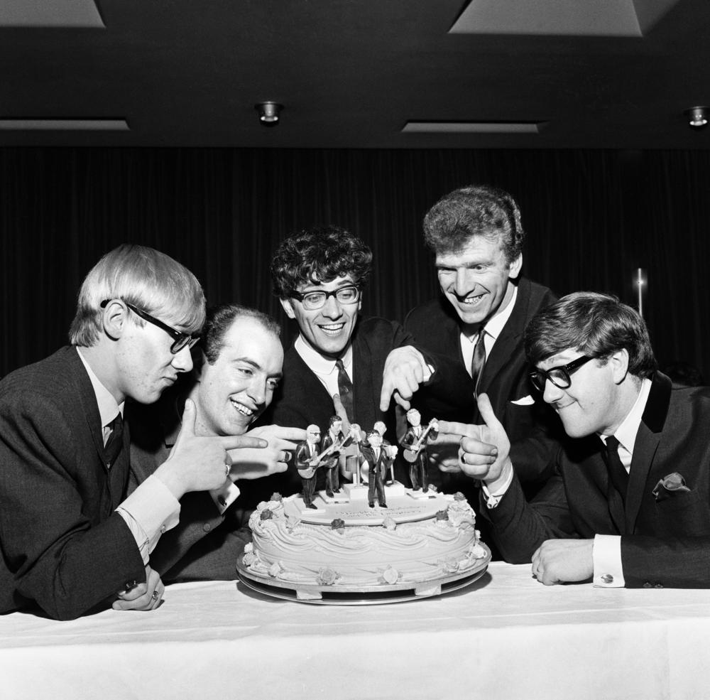 Freddie and the Dreamers pictured with a cake