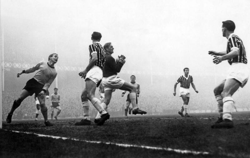 Trautmann is well supported by Manchester City defenders as he catches a shot from Vernon