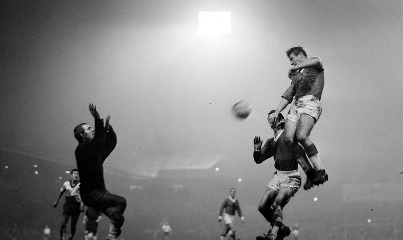 Alex Dawson leaps up above Bayern's Dennis Viollet for the second goal of his hat-rick