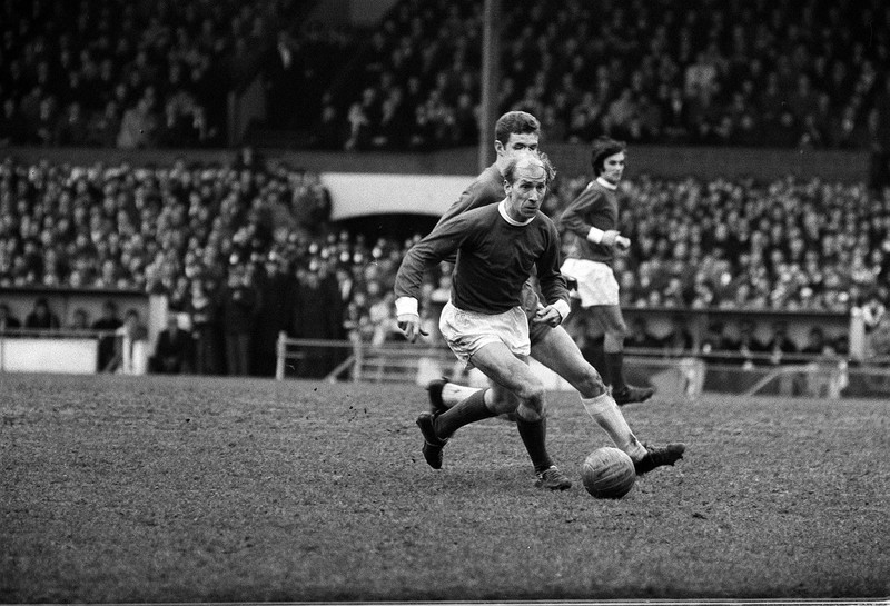 Bobby Charlton in action for Manchester United against Chelsea at Stamford Bridge