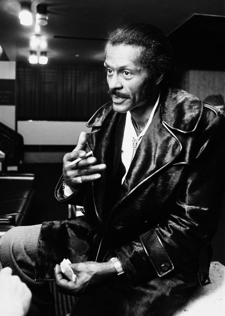 American rock n roll singer Chuck Berry smoking a cigarette after a concert.