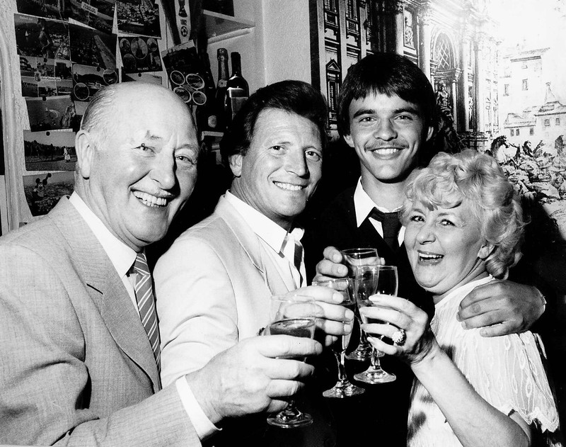 Johnny Briggs with his co stars Bill Waddington left Dave Garratt 2nd right and Lynne Parry drinking a glass of wine or Champagne