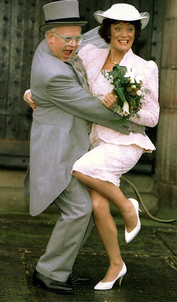 Actors Ken Morley and Sherrie Hewson as Reg Holdsworth and Maureen Naylor getting married