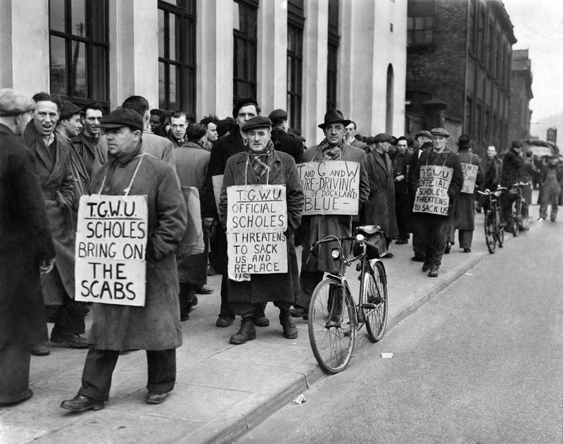Dockers with placards demonstrating in Manchester.