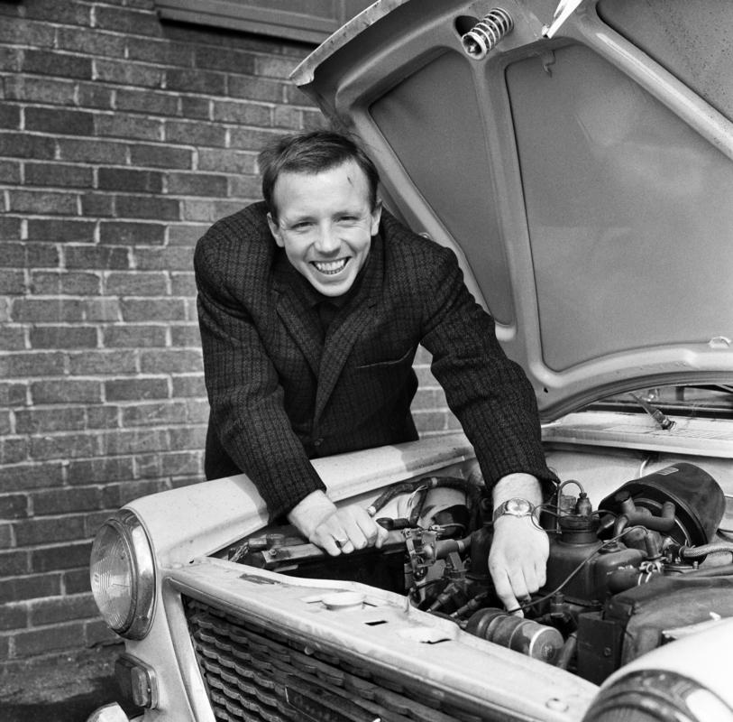 Nobby Stiles Manchester United player tinkering with the engine of his car