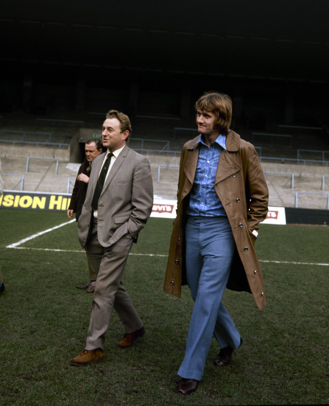 Footballer Rodney Marsh walks around Maine Road with City chairman Eric Alexander