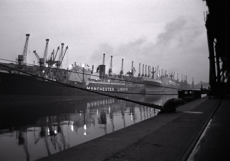 Ships unloading in the docks at Manchester seen through the mist