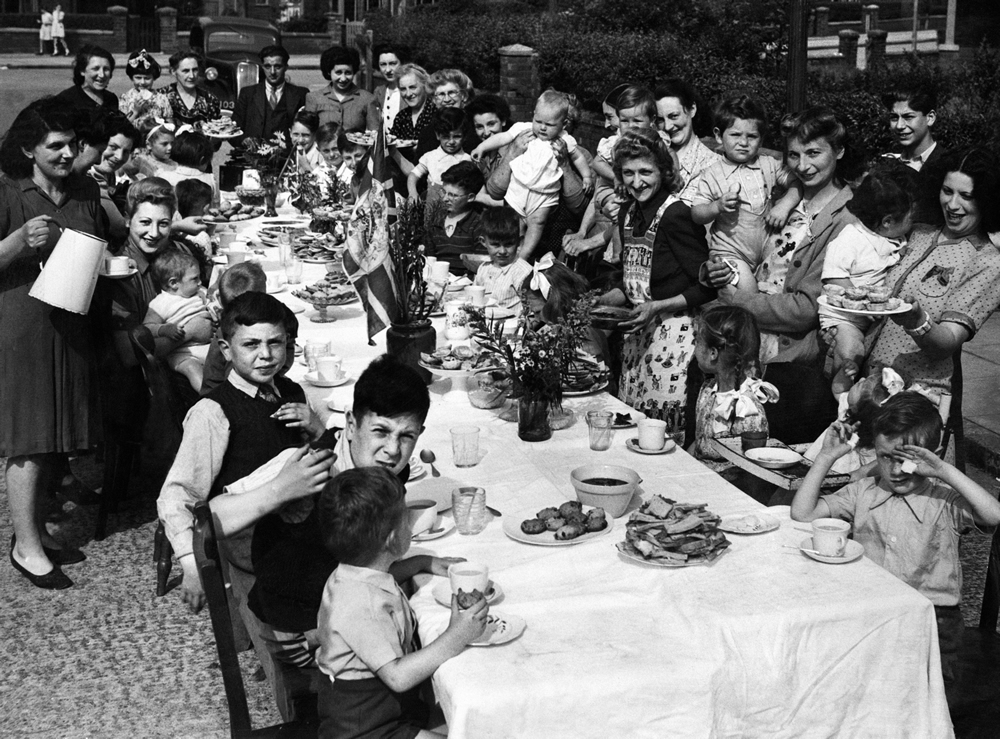 Children tuck into treats at a VE Day party in Heaton Park