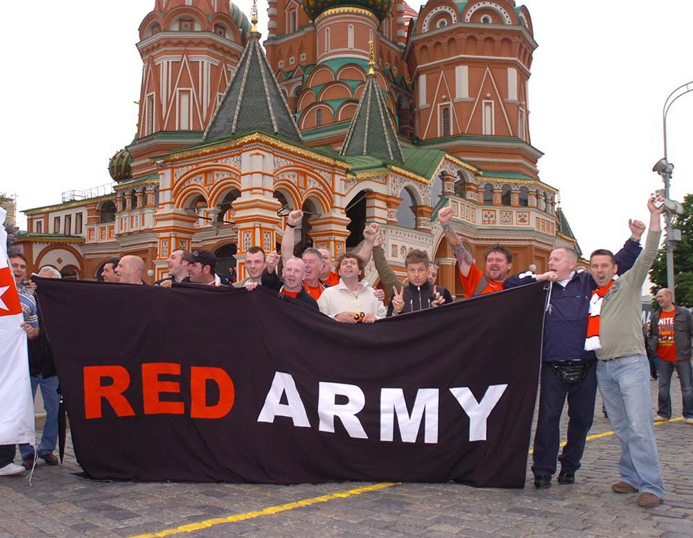 Travelling United fans unveil a fitting banner in Red Square ahead of the 2008 final