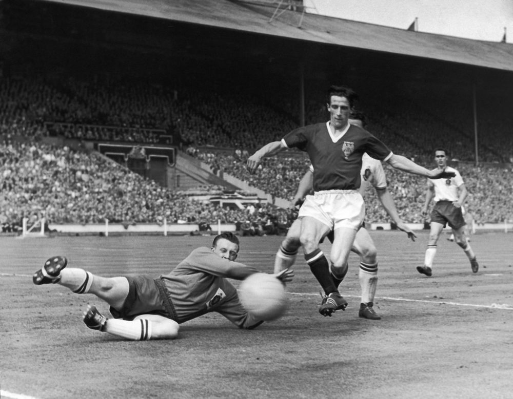 Dennis Viollet is beaten to the ball by Bolton 'keeper Eddie Hopkinson, May 1958