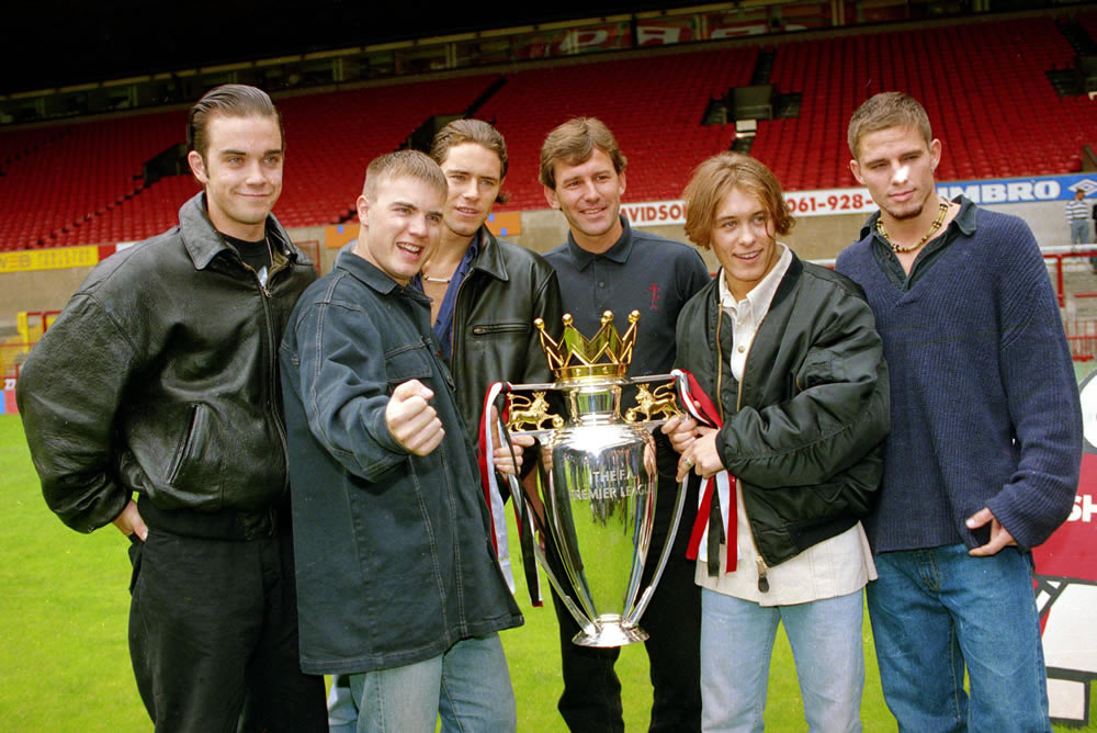 Bryan Robson lines up with Take That and the Premier League trophy, July 1993