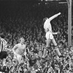 Neil Young leaps in the air after scoring for City against Newcastle