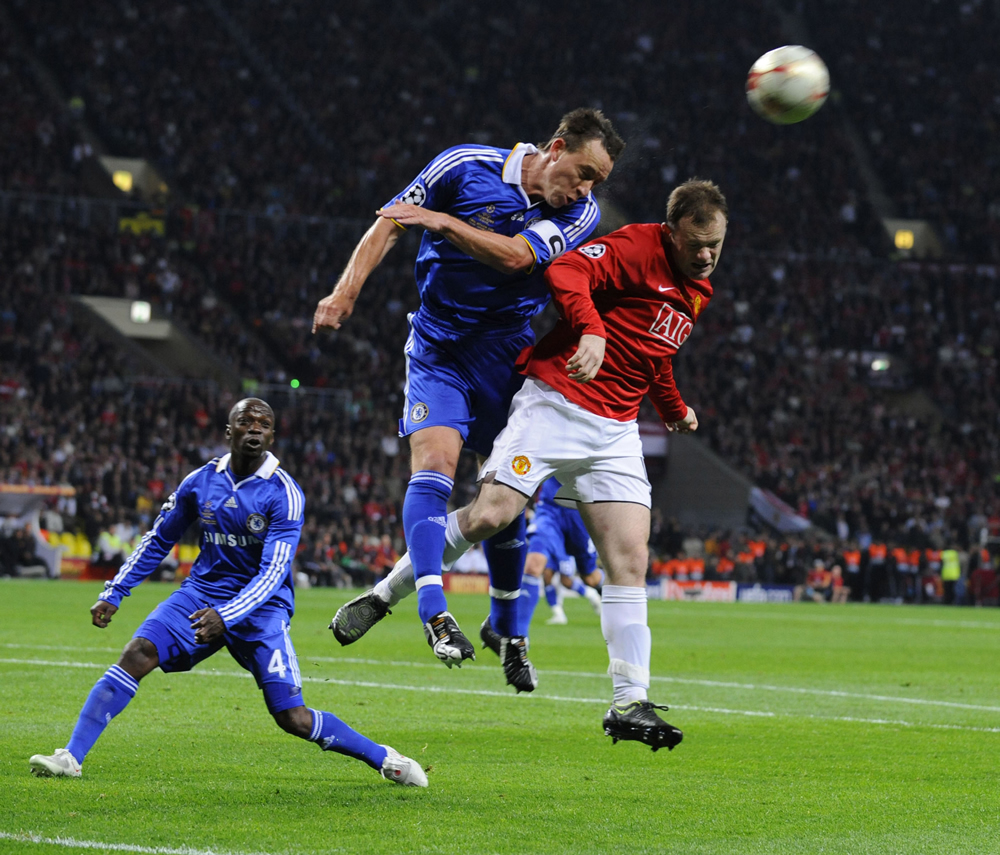 Wayne Rooney jumps for the ball with John Terry in the Luzhniki Stadium, May 2008