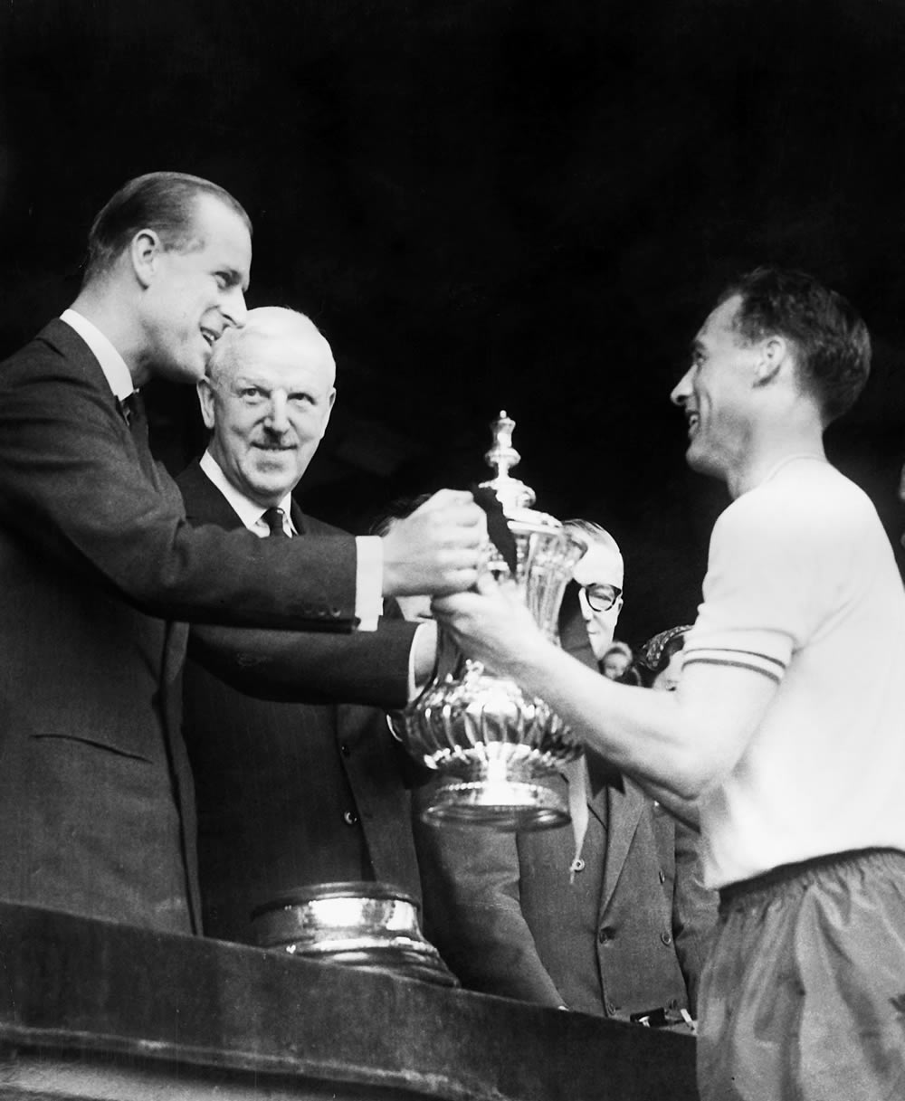 Prince Philip presents the 1958 FA Cup to Nat Lofthouse with Sir Stanley Rous in the background
