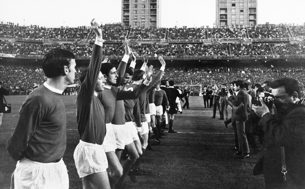 Nervous United players wave to their fans at the Santiago Bernabeu stadium