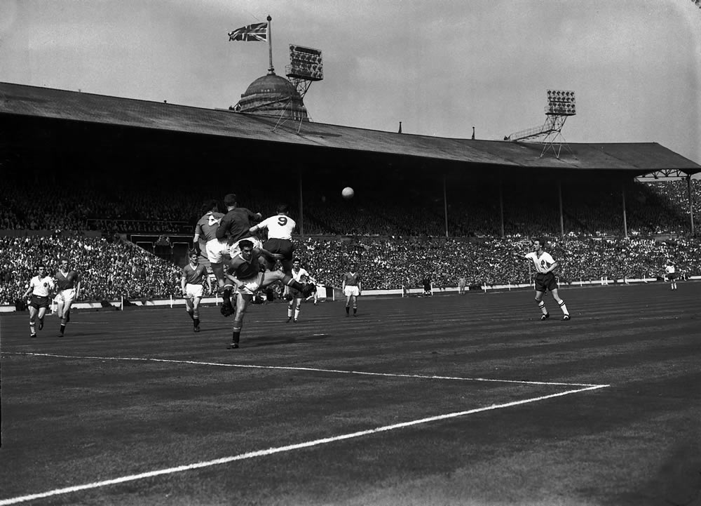 Action from the 1958 FA Cup Final in front of one of Wembley's Twin Towers