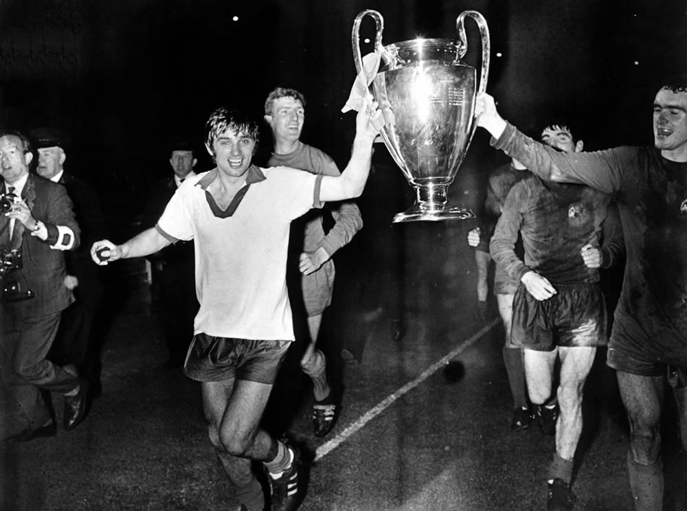 George Best parades the 1968 European Cup after beating Benfica at Wembley