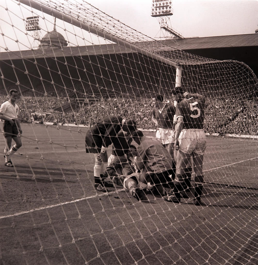 Goalkeeper Harry Gregg gets attention after colliding with Nat Lofthouse, May 1958