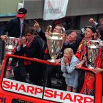 Treble-winners United drive down Deansgate with Alex Ferguson at the front of the bus, May 1999