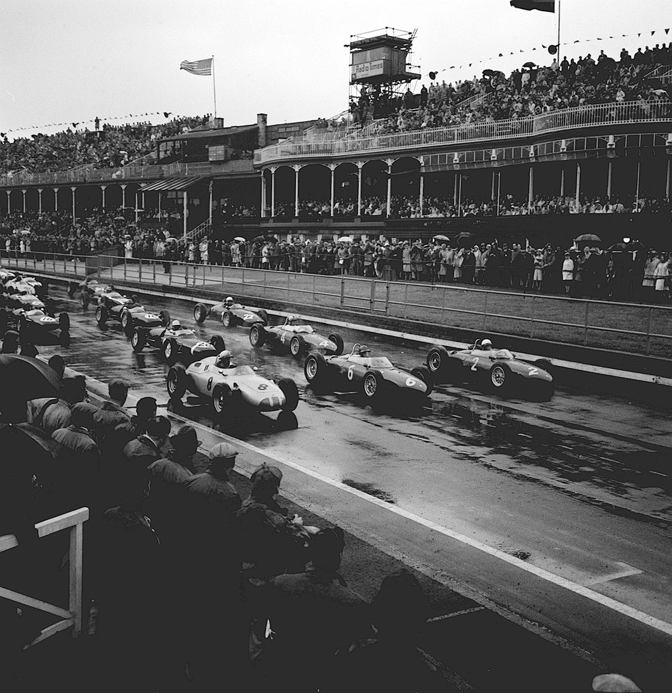 Cars line up at the start of the rain-swept British Grand Prix