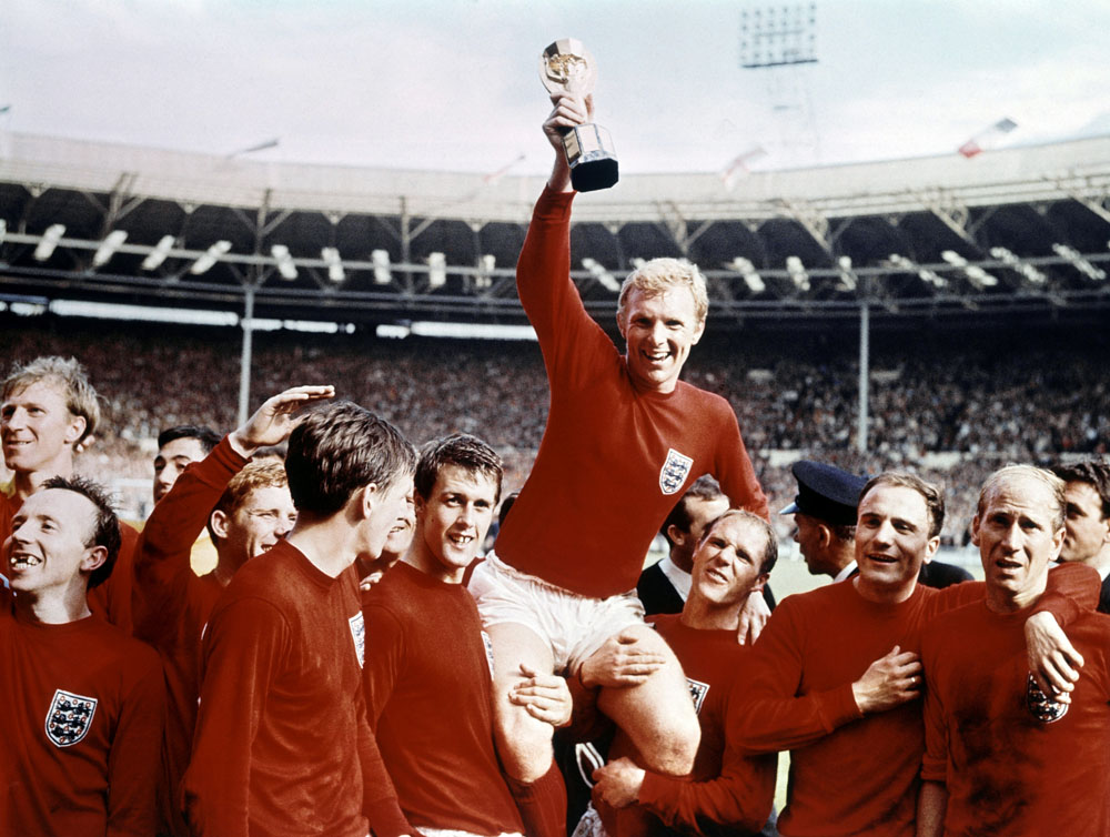 It's ours! United players Nobby Stiles, far left, and Bobby Charlton, far right, celebrate winning the World Cup, July 1966