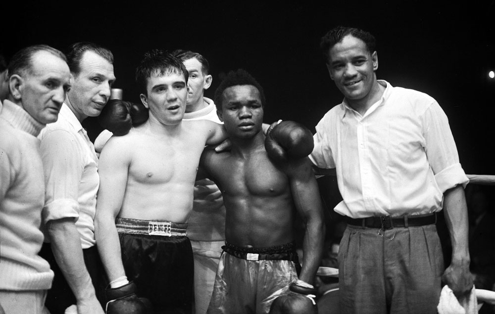 Hogan Bassey, right, after beating Belgian Jean Sneyers on points in Liverpool, May 1954