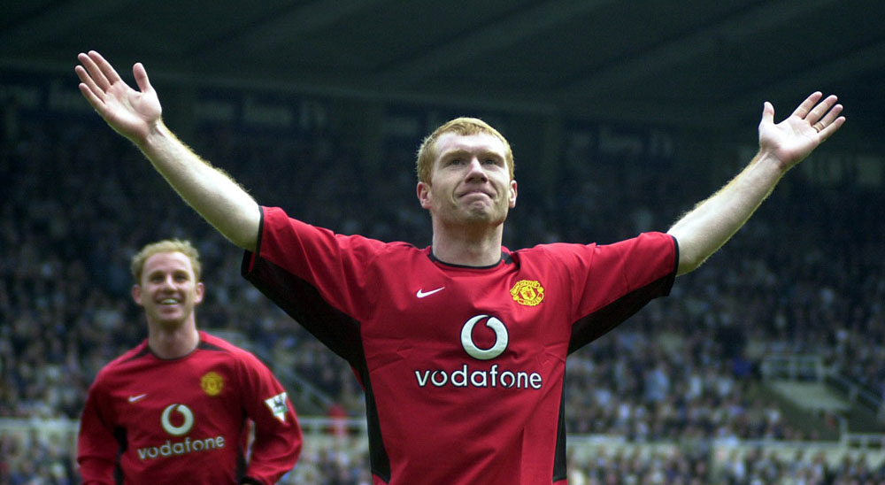 Hat trick! Paul Scholes celebrates his third goal in United's 6-2 victory over Newcastle at St James' Park, April 2003
