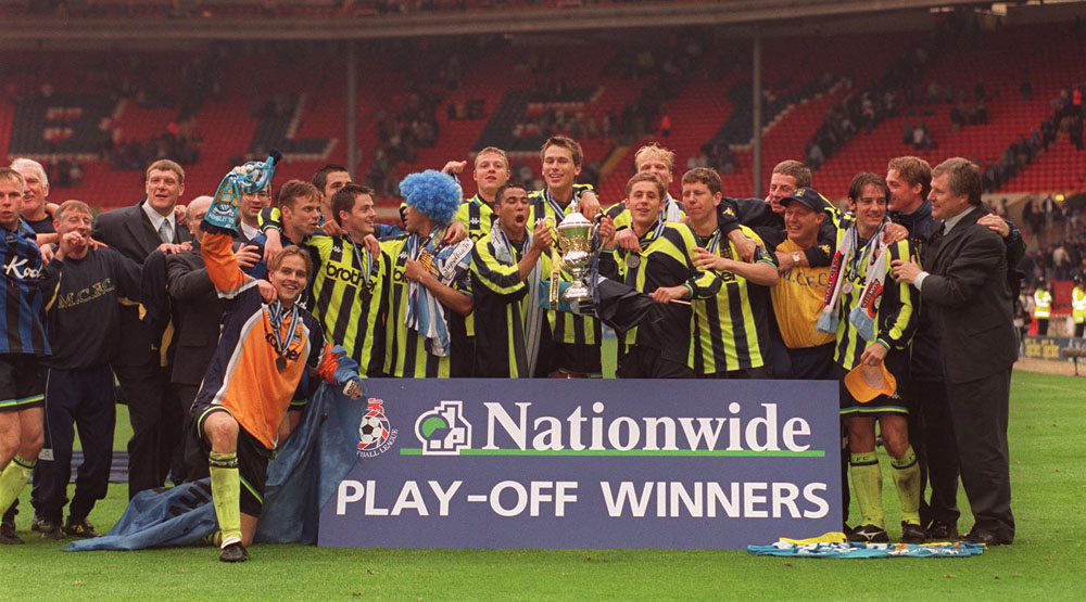 Manager Joe Royle and City players celebrate promotion to Division One, May 1999