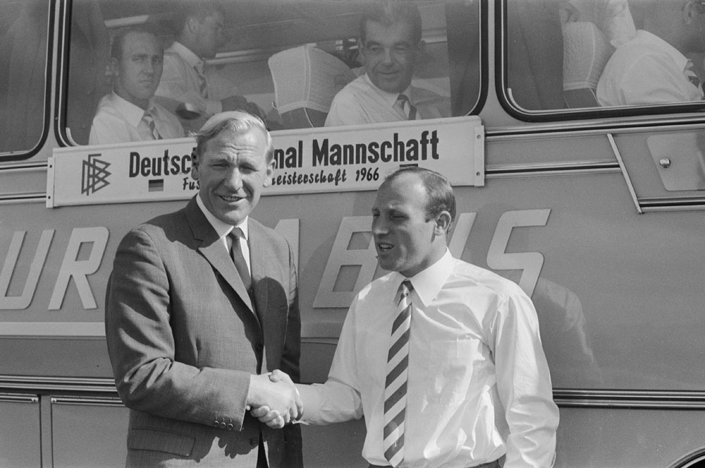 Bert Trautmann, left, welcomes West German captain Uwe Seeler to Manchester, July 1966