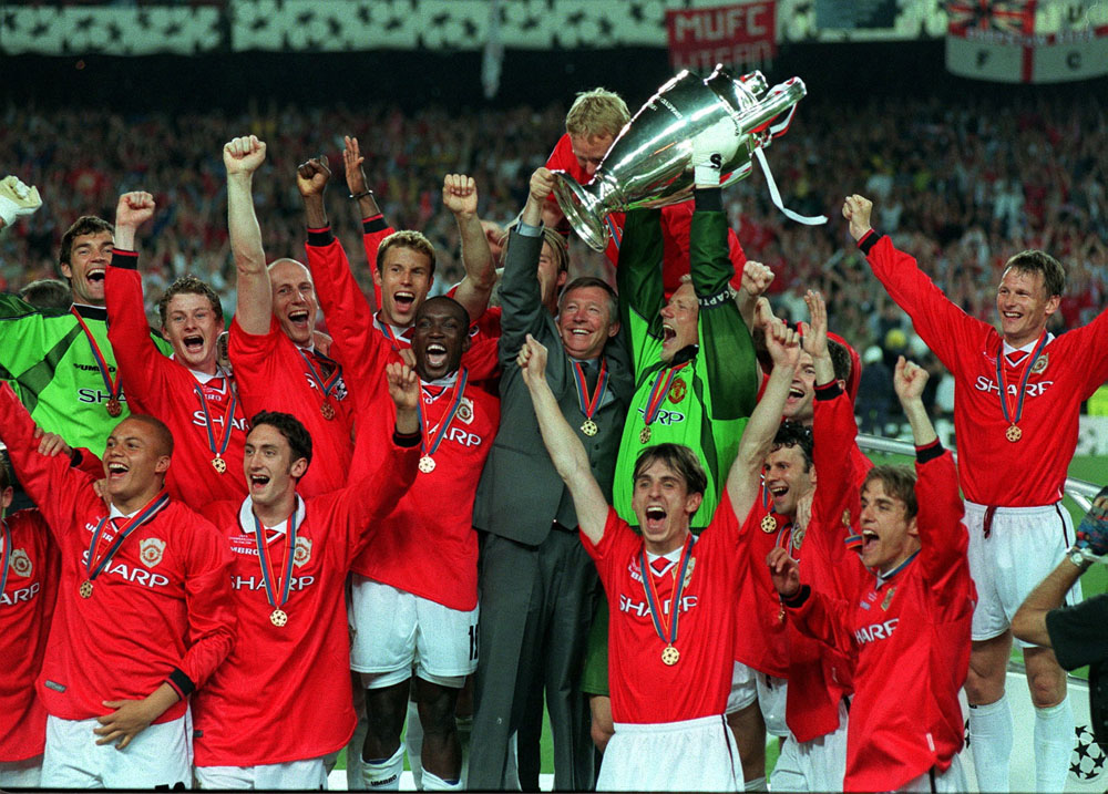United players hold the European Cup aloft after beating Bayern Munich 2-1, May 1999