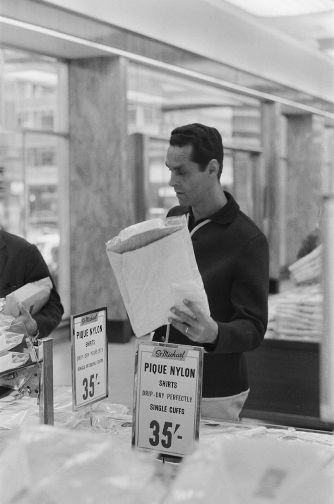 Brazil goalkeeper Gylmar checks prices in a Manchester clothes shop, July 1966