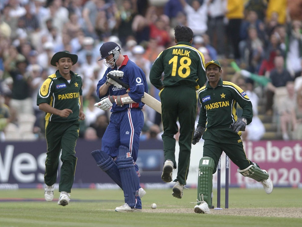 A jubilant Shoaib Malik bowls England's Rikki Clarke for a duck at Old Trafford, June 2003