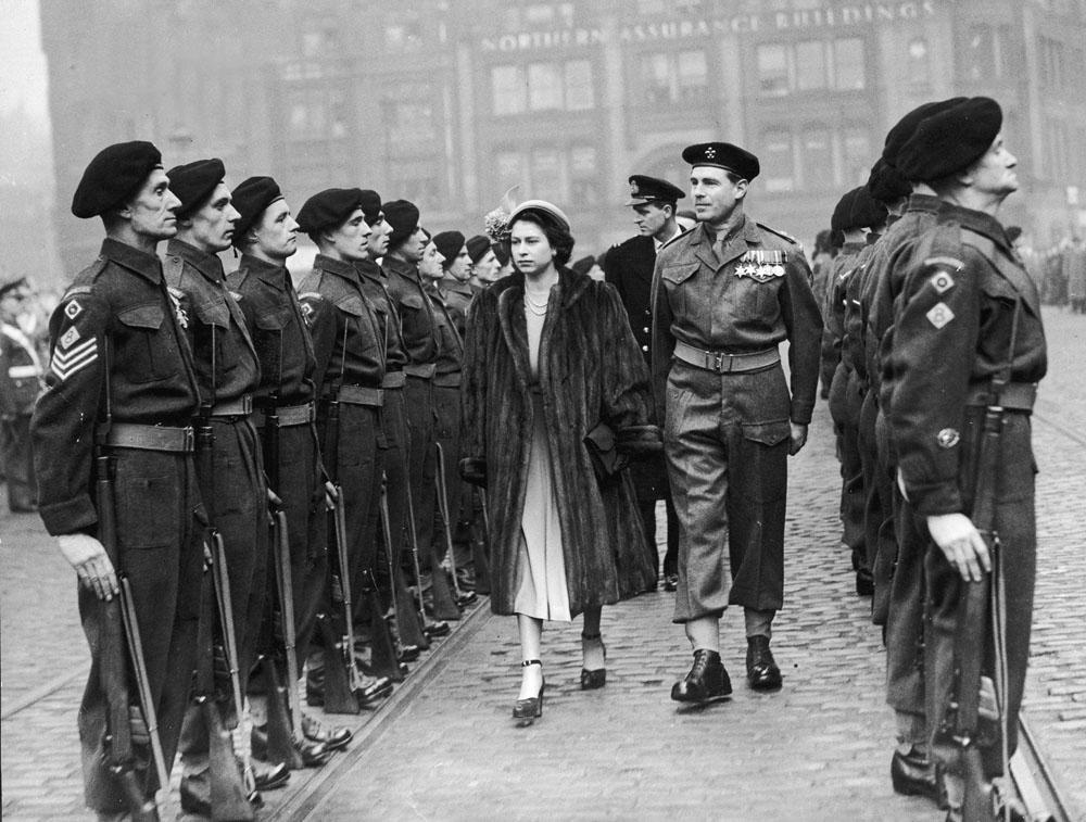 The future Queen and the Duke of Edinburgh inspect troops in Albert Square, March 1949
