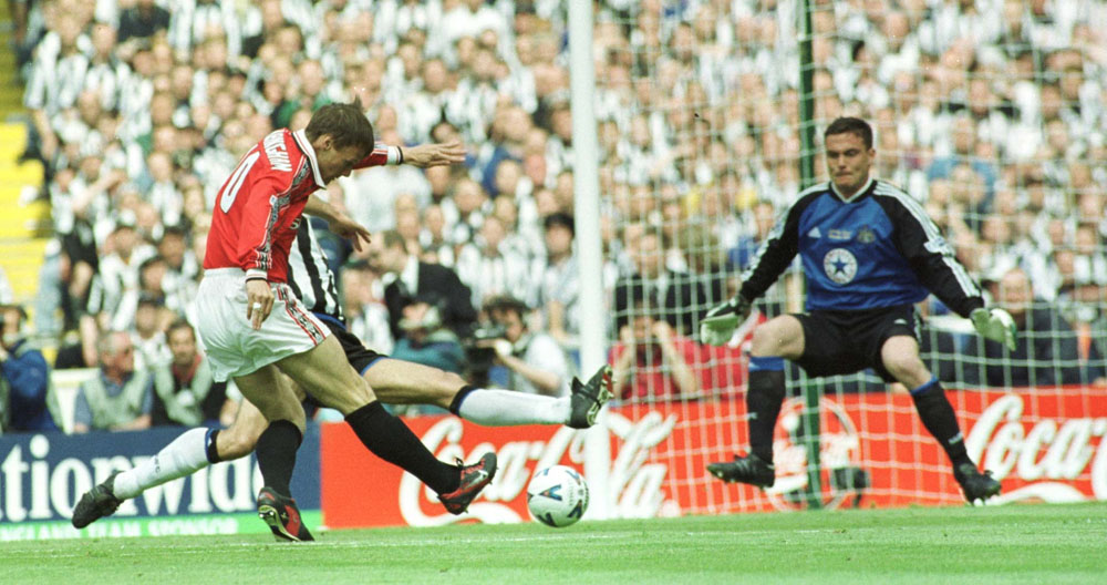 Teddy Sheringham scores against Newcastle 'keeper Steve Harper in the 1999 FA Cup Final