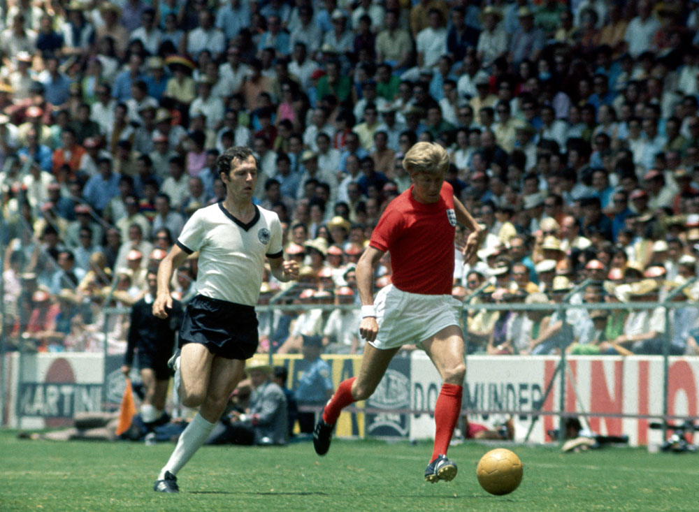 West Germany's Franz Beckenbauer pursues City's Colin Bell in England's 3-2 quarter final defeat, June 1970